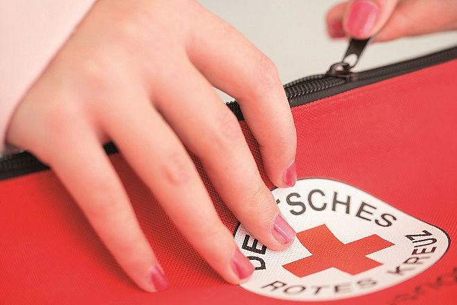 Deutsches Rotes Kreuz, Symbol, Logo, Rundlogo, Rotkreuzlogo, DRK, Hand